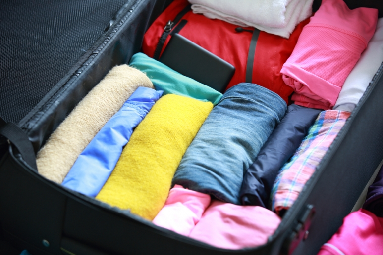 roll-your-clothes-to-save-luggage-space.jpg