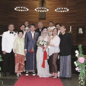 The newlyweds pose together with family